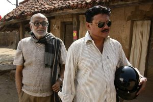 Saswata Chatterjee and Paran Banerjee in Proloy (2013)-cinemabaaz.xyz