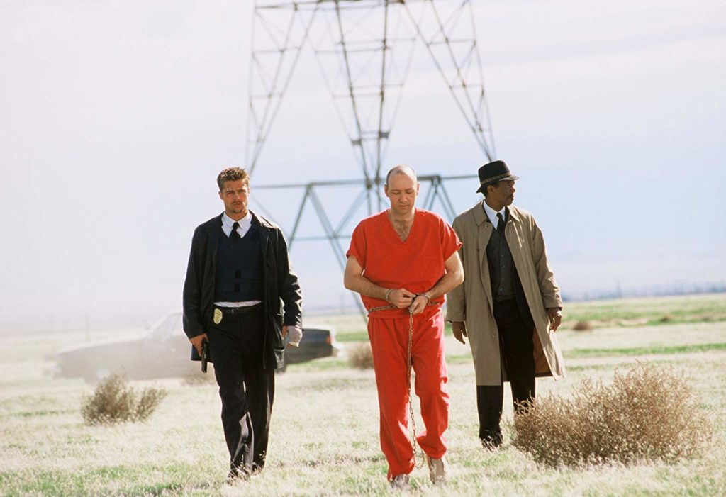 Brad Pitt, Morgan Freeman, and Kevin Spacey in Se7en (1995)-cinemabaaz.xyz